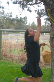 Isabella reaching for a high altitude easter egg